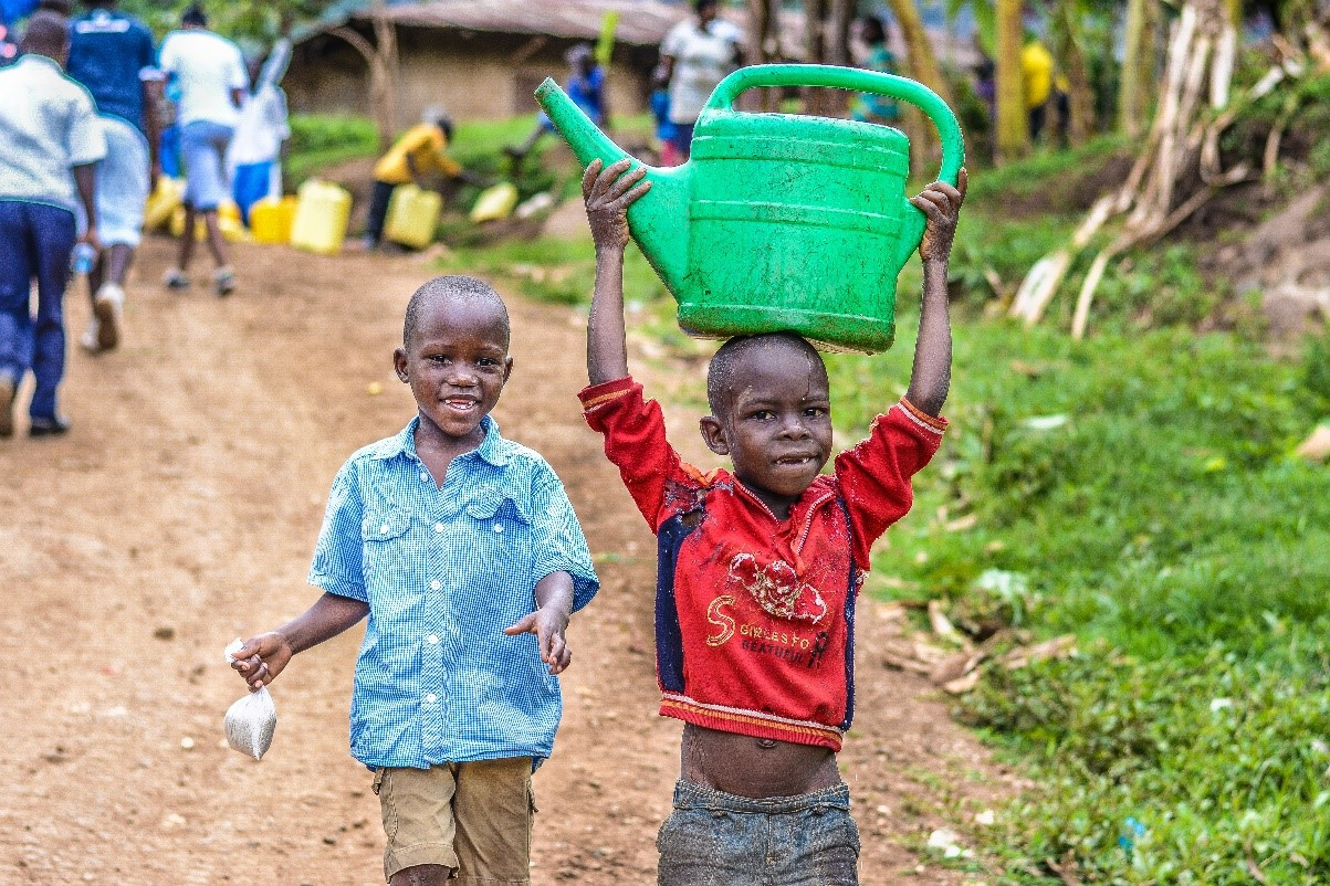 children rushng for miles to get clean water for drinking purposes